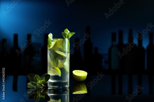Obraz Cocktail Mojito on a black table in a bar. - fototapety do salonu