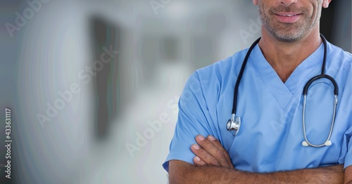 Composition of midsection of male surgeon in scrubs and stethoscope with copy space