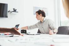 Millennial Businessman Joining Meeting Using Tablet