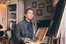 Adult Woman Sitting Painting Studio Searching Creative Inspiration