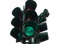 Isolated Traffic Light With Green Light On A Perfect White Background. Milan, Italy.