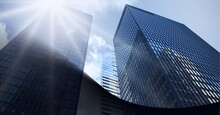 Digital Composite Image Of Abstract Black Geometrical Shapes Against Tall Buildings In Background