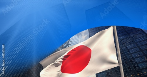 Abstract blue geometrical shapes over japanese flag against tall buildings in background