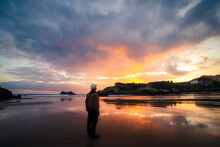 Unrecognizable Man Enjoying A Sunset By The Sea On A Summer Day