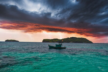 Fishing Boat Floating On A Sea Before A Storm
