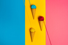 Colorful Woolen Thread Balls In Natural Crunchy Cones Representing Various Gelato On Three Color Background