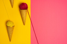 Colorful Woolen Thread Balls In Natural Crunchy Cones Representing Various Gelato On Two Color Background