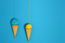 Colorful Woolen Thread Balls In Natural Crunchy Cones Representing Gelato On Blue Background