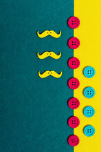 Overhead View Of Colorful Buttons And Mustache On Two Color Background