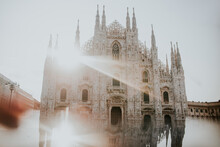 Old Masonry Church Exterior With Ornament Between Buildings Under Shiny Sky In Milan Italy