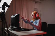 Smiling Female Gamer In Headphones Recording Video On Professional Camera For Social Media Blog