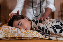 Male Spiritual Therapist Rubbing Hands And Touching Relaxed Female Head With Back During Alternative Therapy