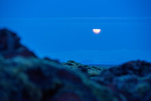 Full Moon Setting Over A Glacier In Iceland Brigh Blue Sky And Snow Textured Iceberg In The Distance Behind Rolling Hills Majestic Wow Awe Inspiring