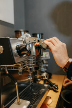 Crop Anonymous Barista Using Milk Frother While Cleaning Coffee Machine In Cafeteria During Work In Daytime