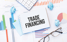 Notepad With Text Trade Financing On The Business Charts And Pen,business
