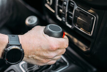 Crop View Of Anonymous Man With Her Hand On The Gear Shift Of An Off-road Car