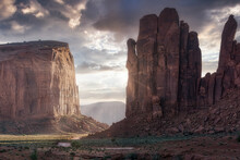 Spectacular Scenery Of Tall Rocky Formations Located In Monument Valley In America Under Colorful Sky At Sunset
