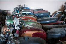 Many Old Fashioned Damaged Rusty Motorcycles Placed In Rows In Repair Service Workshop