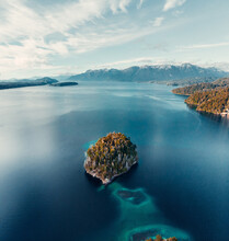 From Above Breathtaking Aerial View Of Island In Calm Lake With Turquoise Water Located In Highlands