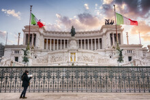 Low Angle Of Female Tourist Standing With Map Near Altar Of The Fatherland With Victor Emmanuel II National Monument During Vacation In Rome