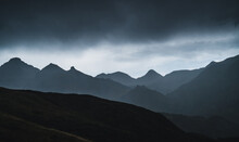 Landscape Of Aran Valley With Majestic Green Hills And Dark Gray Gloomy Sky Above