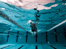 Woman Crawling In A Pool Preparing For A Competition