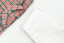 Summer Flat Lay: Shirt With A Pink Check Pattern And White Jeans