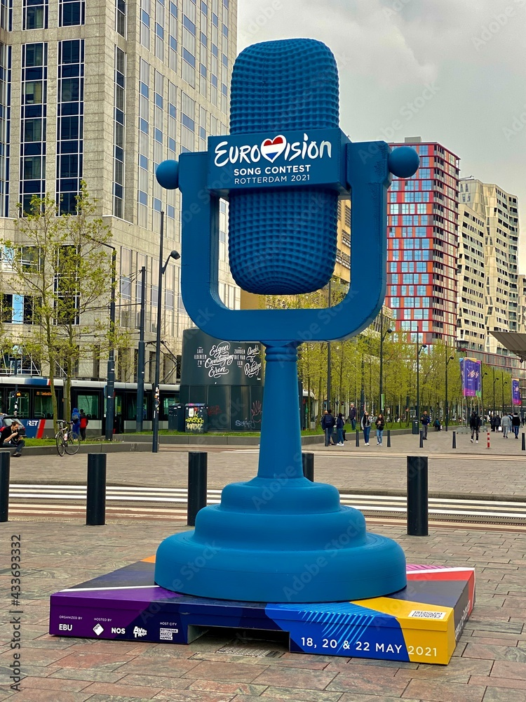 Eurovision Song Contest Rotterdam 2021 blue logo symbol outside Central Railway Station in the city. Large model mock-up of old fashioned microphone as a symbol for European singing contest.
