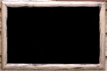 Closeup Of Blank Menu Blackboard Hanging In Pub Or Bar Interior On Grunge Wall. Mock Up. Empty Chalkboard Menu Sign Mockup Isolated On Wood Wall Background.