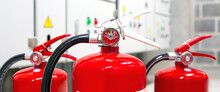 Fire Extinguisher, Close-up Red Fire Extinguishers Tank With Door Exit In The Building Concepts Of Protection And Prevent For Emergency And Safety Rescue And Fire Training.