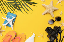 Flat Composition With Beach Holiday Accessories On Yellow Background And Copy Space In The Center, Summer Background