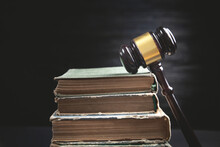 Judge Gavel And Book On The Black Background.