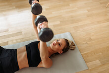 Sports Girl, Lifting Weights, Home Training.