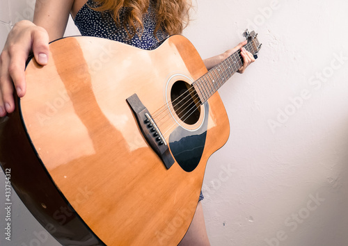 Canvas Beautiful girl with an acoustic guitar