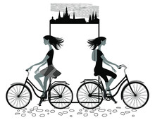 Women Ride Bicycles Against The Background Of A Paper Sheet With A Decorative Frame And A Silhouette Of The Old City. Vector Illustration