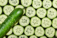 Ripe Cucumber And Sliced Cucumber Slices On A Dark Background, Top View