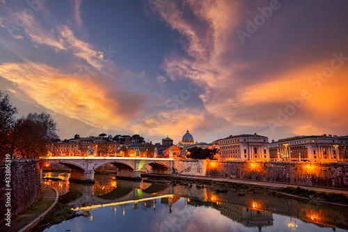 Fototapeta View of the Tiber River and Saint Peter's Basilica at sunset in Rome Italy