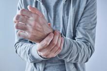 Rheumatoid Arthritis, Man Suffering From Severe Pain In Wrist