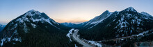 Aerial Panoramic View Of A Scenic Highway Passing In The Canadian Mountain Landscape During A Colorful Spring Sunset. Taken Near Hope And Merritt, British Columbia, Canada.