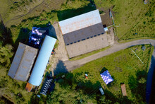 Farm And Farmyard Buildings In Rural Countryside Aerial View From Above