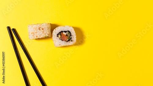 Obraz na płótnie two sushi rolls with copy-space