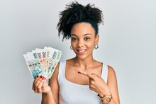 Young African American Girl Holding Czech Koruna Banknotes Smiling Happy Pointing With Hand And Finger
