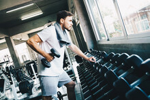 Smart Sport Man Lifting Dumbbell Up In Fitness Gym Wellnes Activity