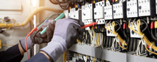 Electrician Engineer Tests Electrical Installations And Wires On Relay Protection System. Adjustment Of Scheme Of Automation And Control Of Electrical Equipment.