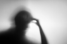 Conceptual Photo. Motion Blurred Image. Silhouette Of Senior Elderly Person Who As Parkinson Or Alzheimer Disease. Memory Loss From Dementia. Brain Function Decline