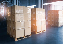 Stack Of Package Boxes Load Into Shipping Container. Trailer Truck Parked Loading At Dock Warehouse. Delivery Service. Shipping Warehouse Logistics. Shipment Freight Truck Transportation.