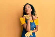 Middle Age African American Woman Wearing Professional Apron Looking At The Camera Blowing A Kiss With Hand On Air Being Lovely And Sexy. Love Expression.