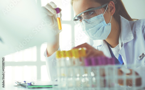 Fotografiet Researcher, doctor, scientist or laboratory assistant working with plastic medic