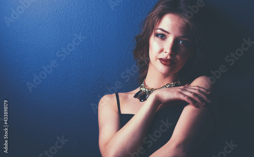 Fotografiet Beautiful woman with evening make-up in black dress