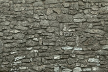 Wall Of Old Ancient Fortress. Stony Wall Texture. Medieval Broadwall Surface. Old Antique Stony Bailey. Ancient Castle Wall.  Rubble Face. Ruin Wall.